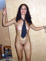 Latin girlfriend shows her firm breasts..