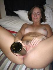 Drunk girlfriend inserts bottle in pussy