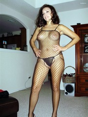 Brunette MILF wearing fishnet body..