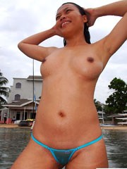 Gorgeous asian wife shows her breasts..